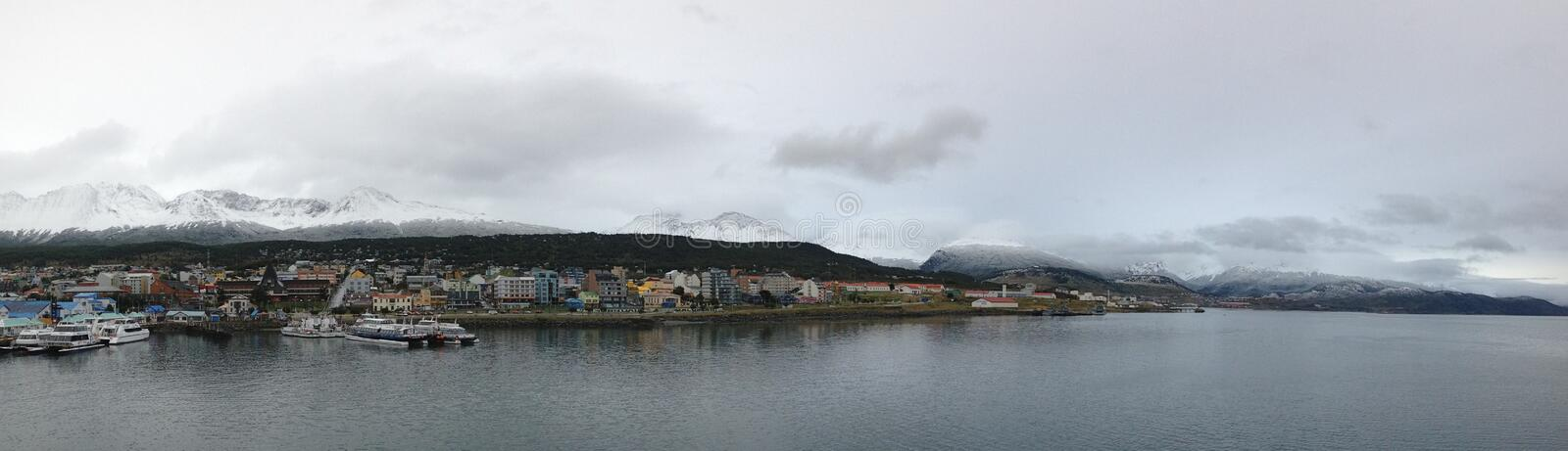 """Ushuaia located at the southernmost tip of South America, nicknamed the """"End of the World"""". And surrounded by the Martial Mountains stock image"""