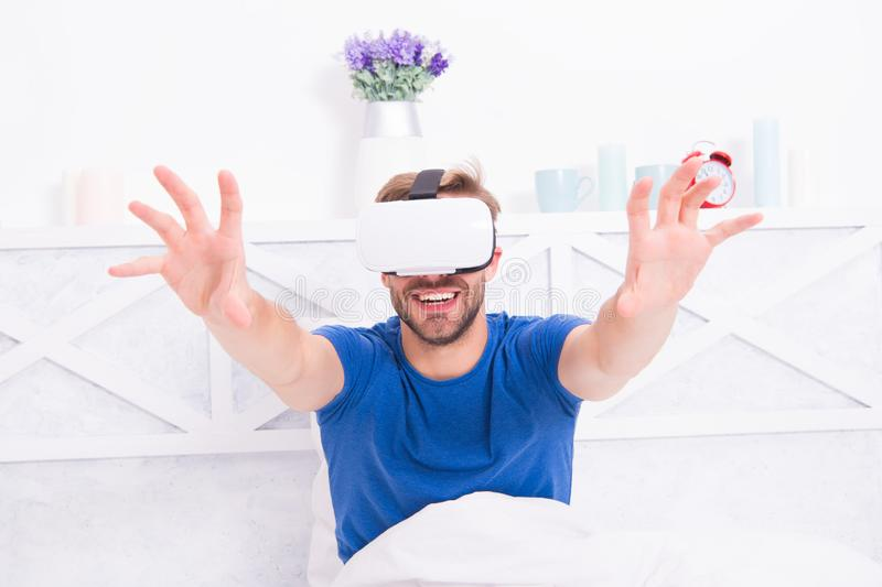 Using computer technology to create a simulated environment. Happy guy wearing VR headset for computer gaming. Handsome. Man playing virtual computer games in royalty free stock image
