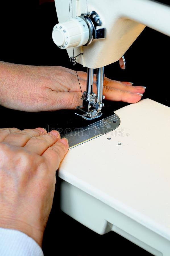 Using a domestic sewing machine. royalty free stock photo