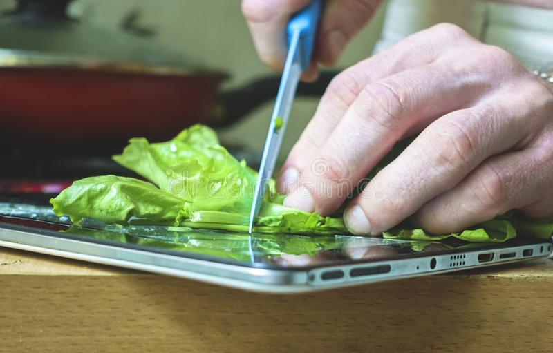 Using an electronic tablet for cooking stock photography