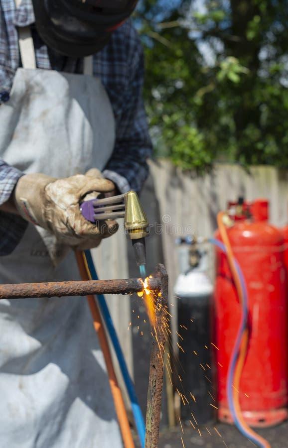 Using Gas Cutting Torch stock photos