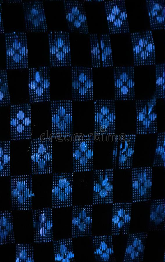 USING GLOWING SATIN THREADS AND MAKING SEAMLESS PATTERNS. A waiver used glowing satin threads and knitted in hand and make a glowing seamless patterns royalty free stock image
