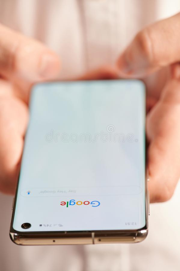 Using google search mobile app. New york, USA - july 22, 2019: Using  google search mobile app close up view, smartphone in hands stock photography