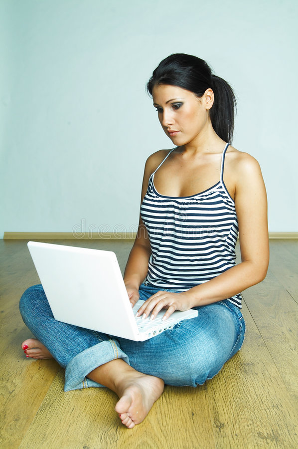 Using laptop computer stock image
