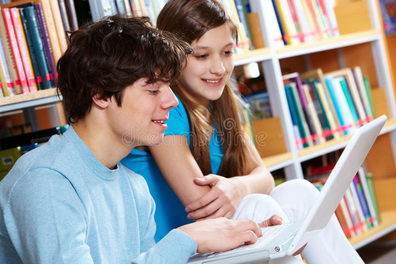 Download Using laptop at library stock photo. Image of library - 26816928
