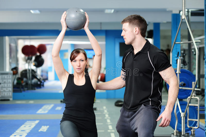 Using medicine ball with personal trainer stock photos