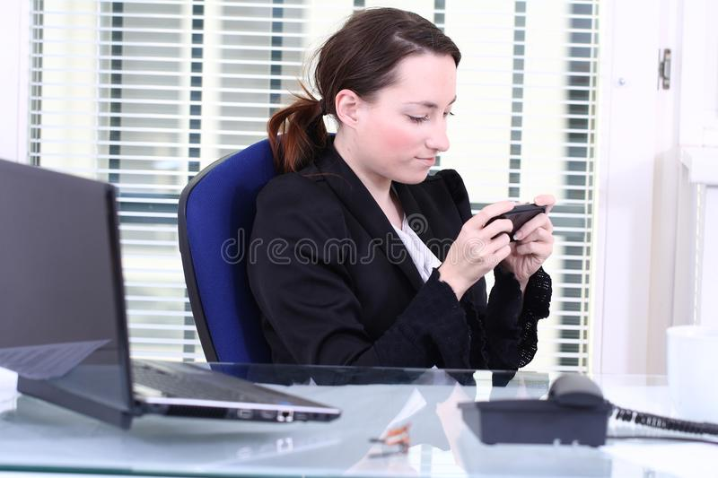 Using Private Mobile At Work Royalty Free Stock Photo