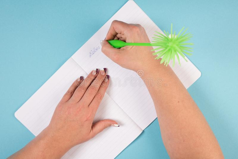 Writing in a diary stock photography