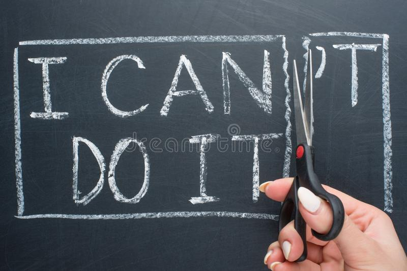 using scissors to remove the word can & x27;t to read I can do it concept for self belief, positive attitude and motivation royalty free stock photo