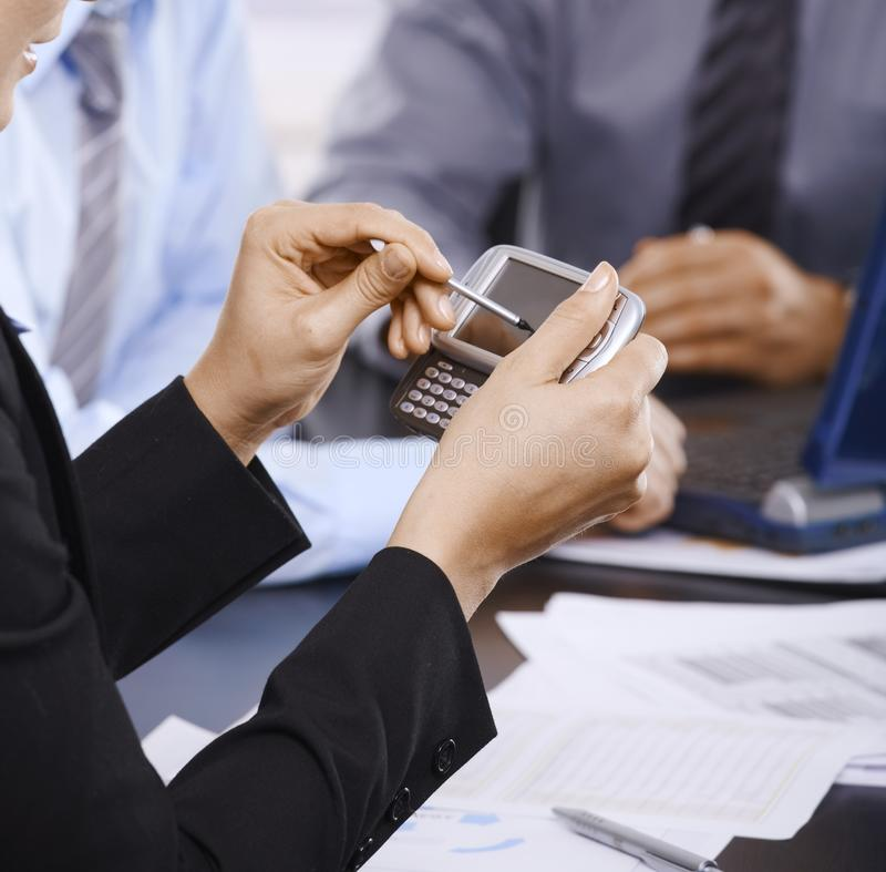 Download Using smartphone stock image. Image of colleagues, cooperating - 13504997