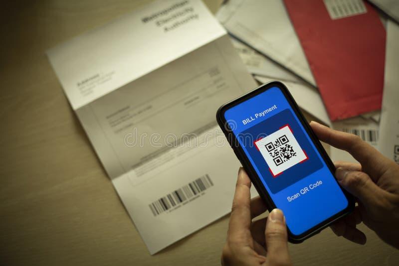 women hold smartphones in handscanning stores qr code to
