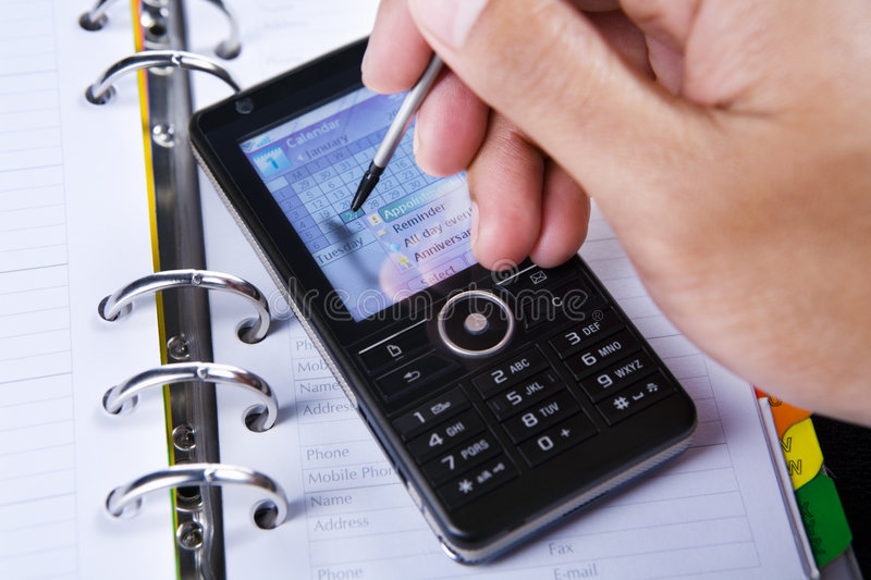 Download Using Stylus On Touch Screen Cell Phone Stock Image - Image: 7839061