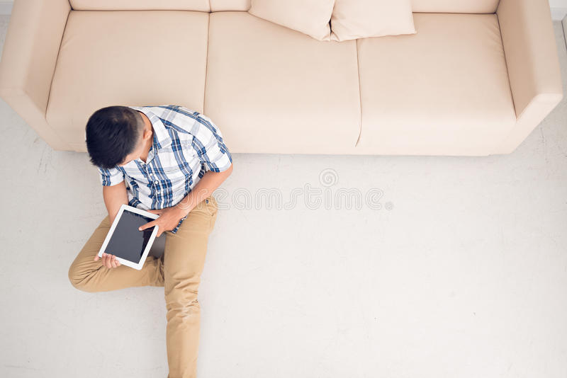 Using tablet at home stock image