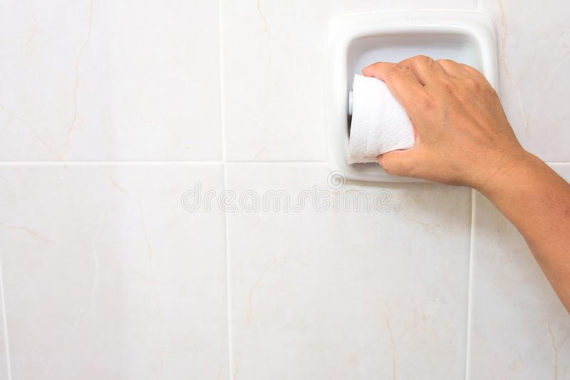 Using Toilet Paper in toilet. diarrhea constipation.Health concept stock images