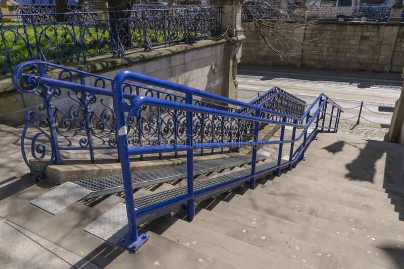 Stairs With Ramp For Disabled Persons And Baby Carriages In The Centre Of  Krakow. Poland.