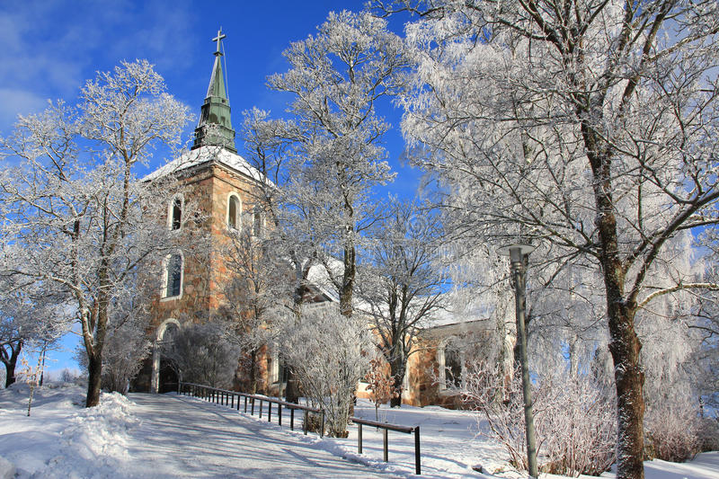 Uskela Church in Salo, Finland. In winter with hoarfost on trees royalty free stock images