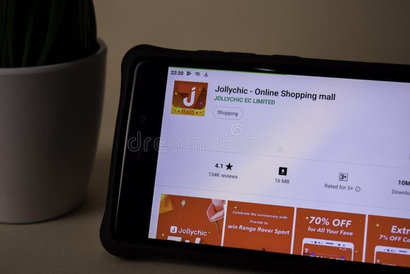 Uso del revelador de Jollychic en la pantalla de Smartphone El centro comercial en línea es un freeware imágenes de archivo libres de regalías