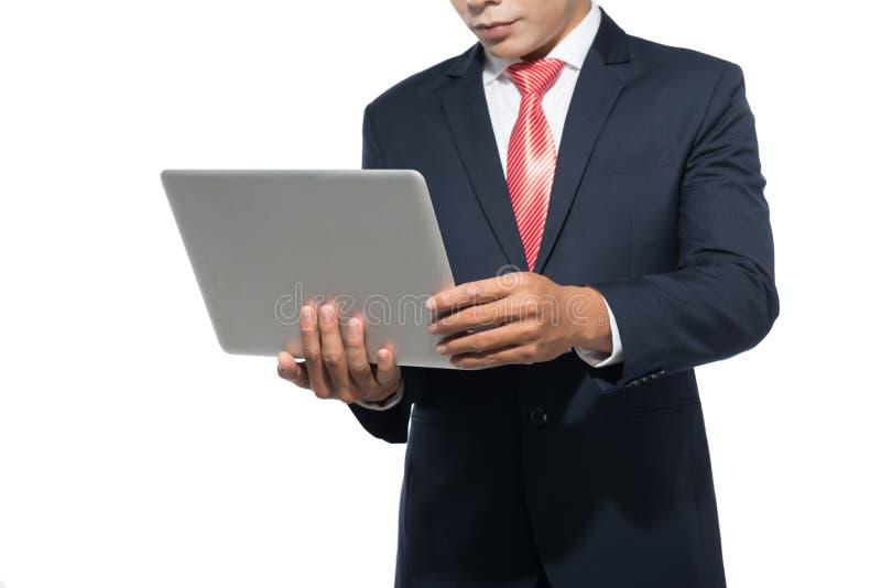 Uso do homem de negócios do laptop fotos de stock