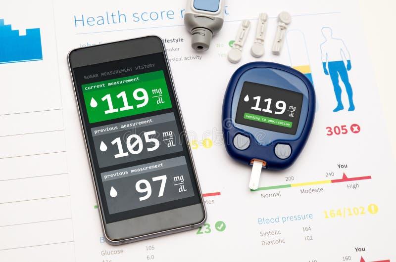 Uso para la diabetes en smartphone imagen de archivo
