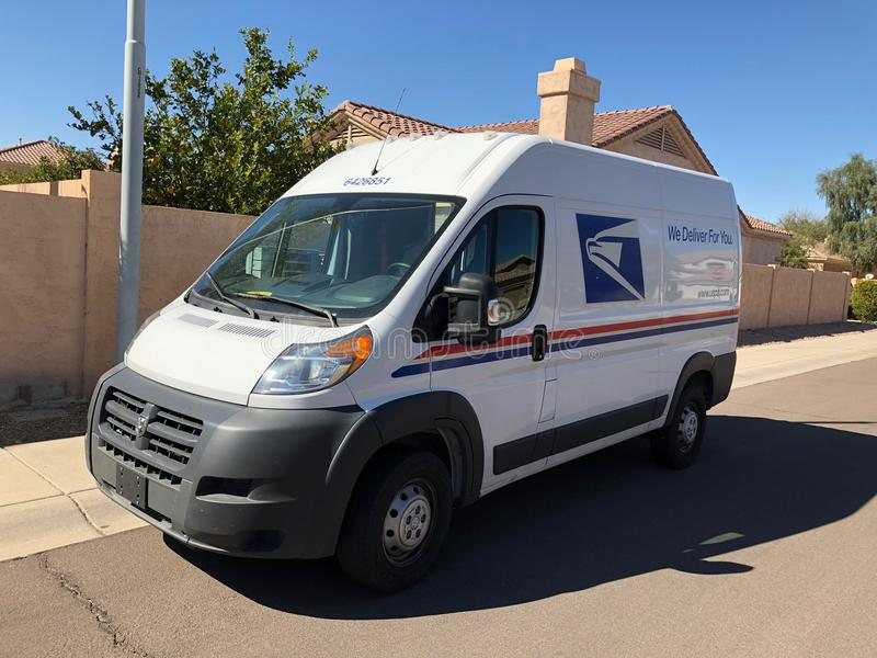 USPS Delivery Van In Arizona. A United States Postal Service, USPS, collection and delivery van in a residential neighborhood. The USPS is responsible for stock images
