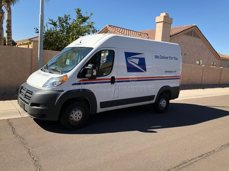USPS Delivery Van In Arizona. A United States Postal Service, USPS, collection and delivery van in a residential neighborhood. The USPS is responsible for royalty free stock photo