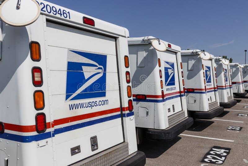USPS-stolpe - kontorspostlastbilar Stolpen - kontoret är ansvarigt för att ge postleverans VIII royaltyfri fotografi