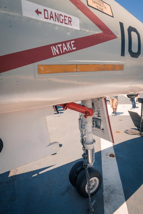 Jet intake under wing of aircraft aboard USS Midway aircraft carrier museum at the San Diego Harbor California clear summer day. The USS midway is a retired royalty free stock images