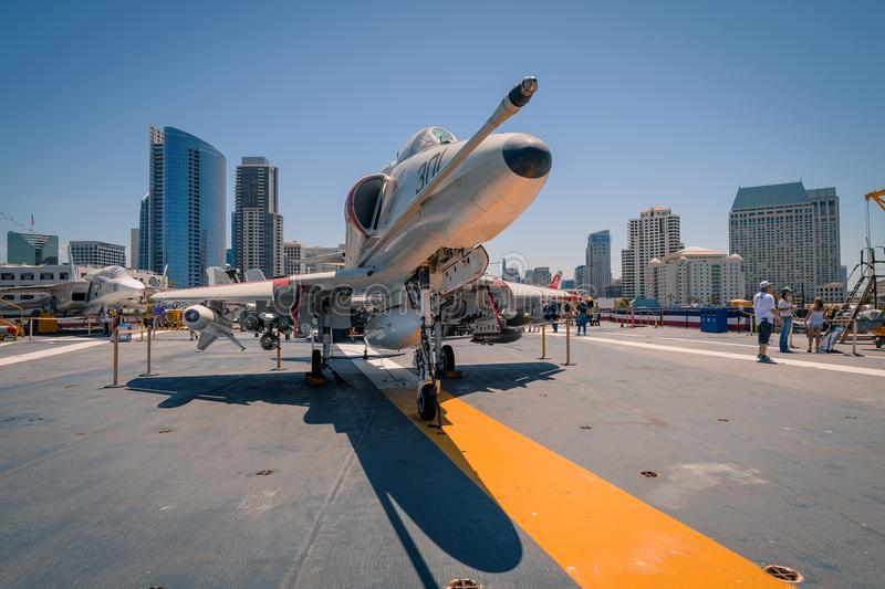 A-4 Skyhawk attack plane on board USS Midway aircraft carrier museum at the San Diego Harbor California clear summer day. The USS midway is a retired aircraft royalty free stock images