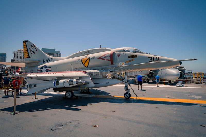 A-4 Skyhawk attack plane on board USS Midway aircraft carrier museum at the San Diego Harbor California clear summer day. The USS midway is a retired aircraft royalty free stock photography
