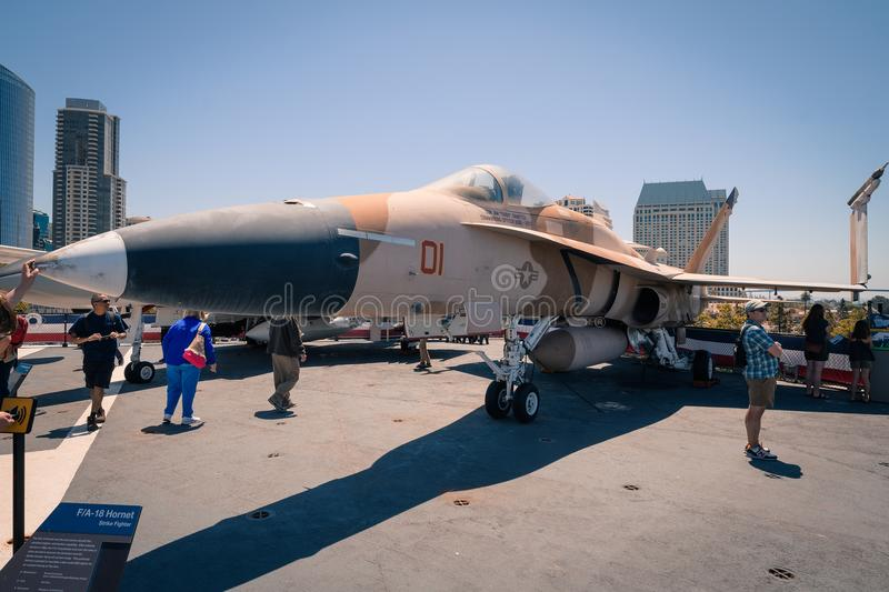 F/A 18 Hornet Striker on board Uss Midway aircraft carrier museum at the San Diego Harbor California clear summer day. The USS midway is a retired aircraft royalty free stock photo