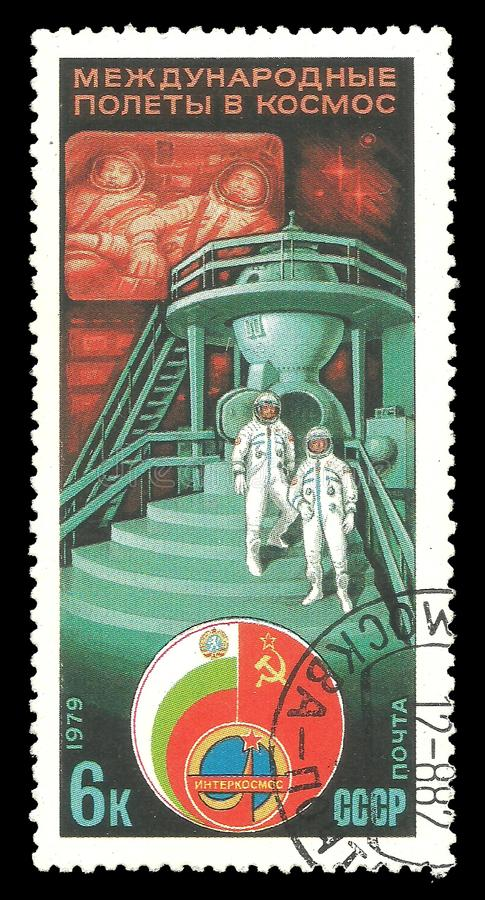 Astronauts, spaceship and state flags. USSR - circa 1979: Stamp printed by USSR, Color edition on Soviet Bulgarian Space Flight, shows Astronauts spaceship and royalty free stock images