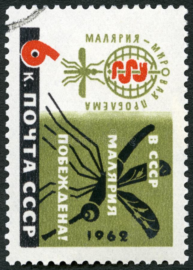 USSR - 1962: shows Malaria Eradication Emblem and Mosquito. USSR - CIRCA 1962: A stamp printed in USSR shows Malaria Eradication Emblem and Mosquito, circa 1962 stock photos