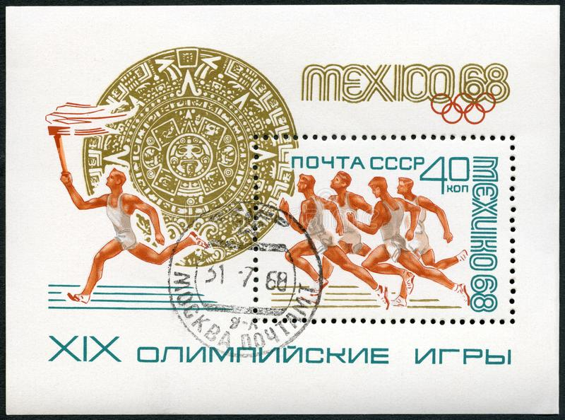USSR - 1968: shows sportsman with torch, 19th Olympic Games, Mexico City stock image