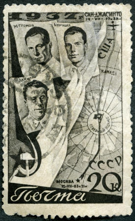 USSR - 1938: shows Aviators Gromov, Danilin, Yumashev and Flight Route, First Trans-Polar flight, June 18-20, 1937. USSR - CIRCA 1938: A stamp printed in USSR stock photos