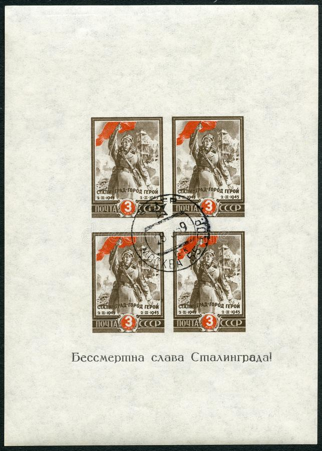 USSR - 1945: shows soldier with red flag, Battle of Stalingrad, hero city, Second anniversary of victory at Stalingrad. USSR - CIRCA 1945: A stamp printed in stock photos
