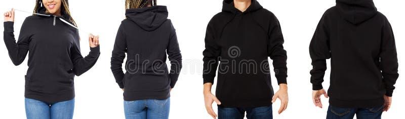 Ustalony czarny mockup odizolowywający hoodie przód i tylni widoki - mężczyzna i kobieta w eleganckiej czarnej bluzie sportowej w zdjęcia stock