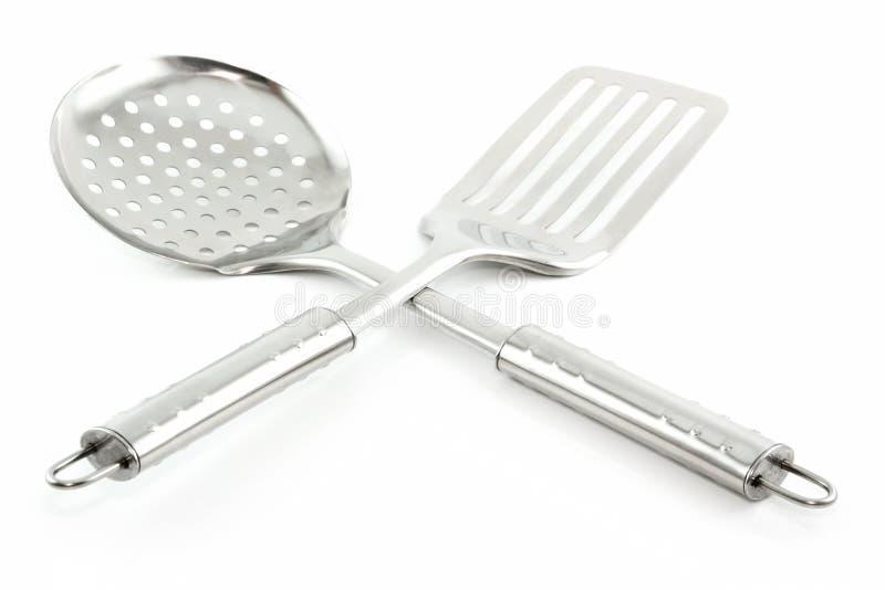 Ustensiles de cuisine (passoire et spatule) d'isolement photo libre de droits