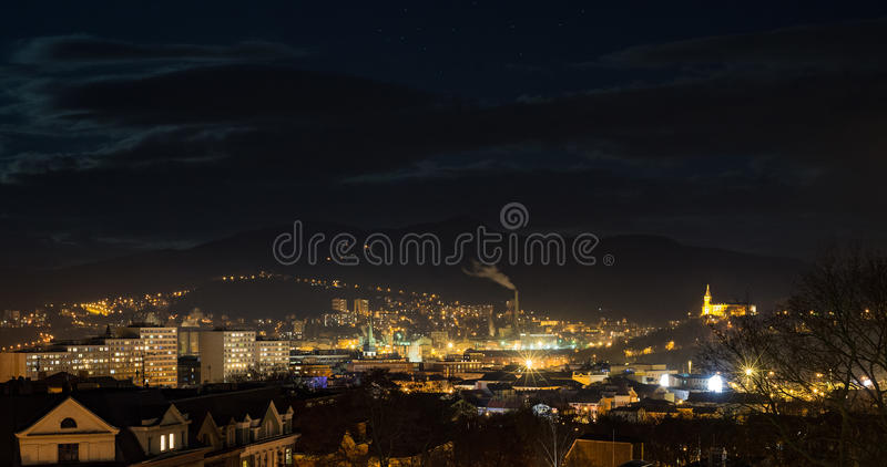 Usti nad Labem skyline at night. Night skyline view of modern industrial city with block houses, factory and small chateu Vetruse. Usti nad Labem, Czech republic stock images