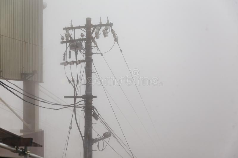 Usuzan Ropeway pole that cable disappear in the fog, view from Mount Usu in Hokkaido, Japan.  royalty free stock photos