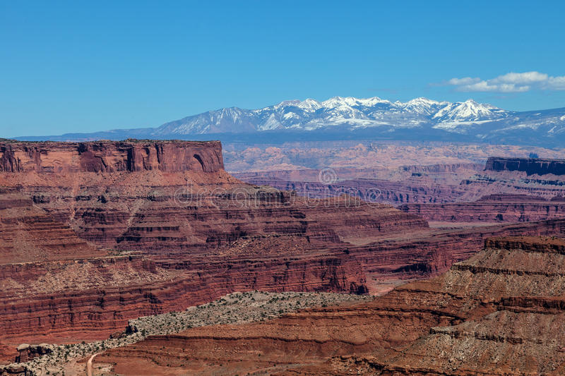 Utah-Canyonlands National Park-Island in the Sky District. This area of Island in the Sky affords one spectacular views of the Manti la Sal Mountains and the royalty free stock photos