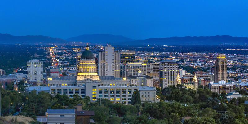 Utah State Capital Building view at twilight. Salt Lake City with the majestic Utah State Capital Building at twilight. A scenic view of the populous city with stock image