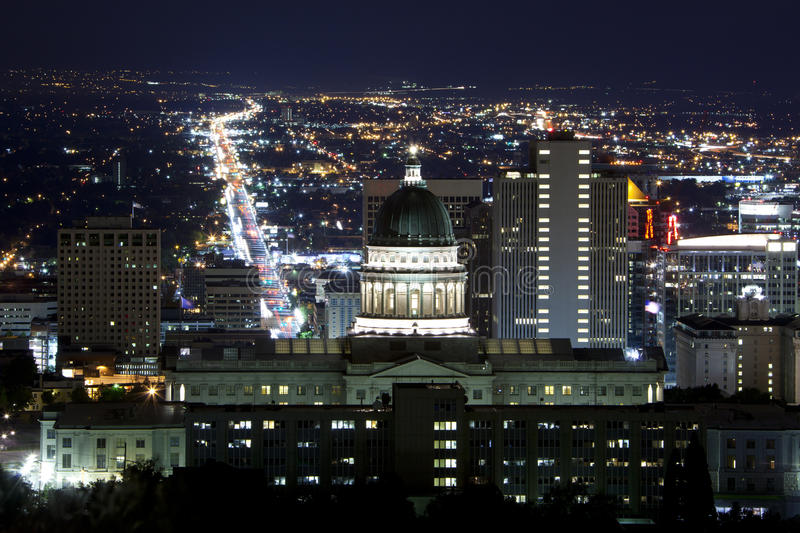 Utah State Capitol. A view of Utah State Capitol at night with Salt Lack City in the background royalty free stock image