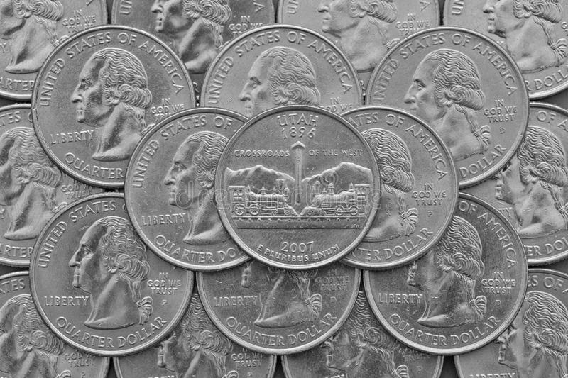 Utah State and coins of USA. Pile of the US quarter coins with George Washington and on the top a quarter of Utah State stock images