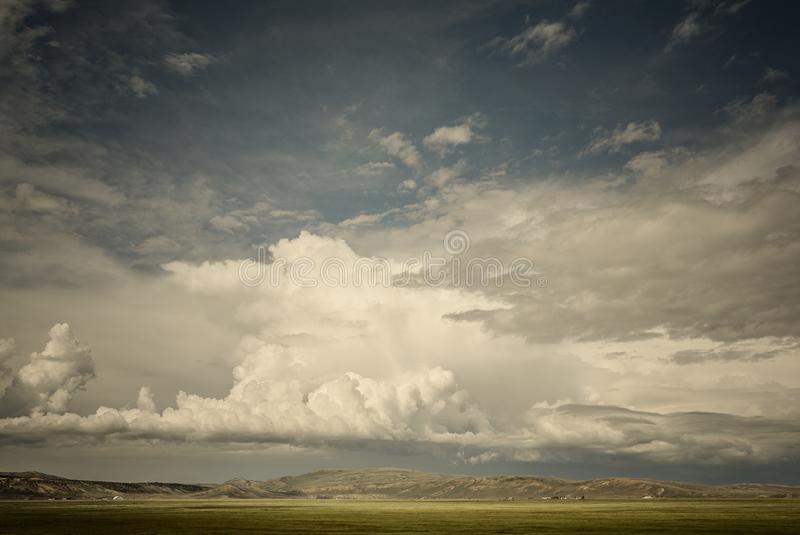 Utah - A Summer Thunderstorm Builds North Of The Hayden Valley. A Summer Thunderstorm Builds Over The Ranch Lands Along Hwy 150 North Of The Hayden Valley royalty free stock photography