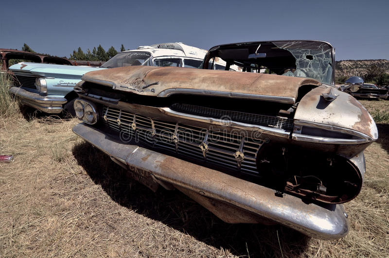 Utah - United States. Old broken Cadillac in middle of desert in Utah - United States stock images
