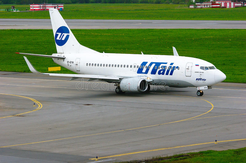 UTair Airline Boeing 737-500 aircraft in Pulkovo International airport in Saint-Petersburg, Russia. SAINT-PETERSBURG, RUSSIA - MAY 23, 2015. UTair Airline Boeing royalty free stock photography