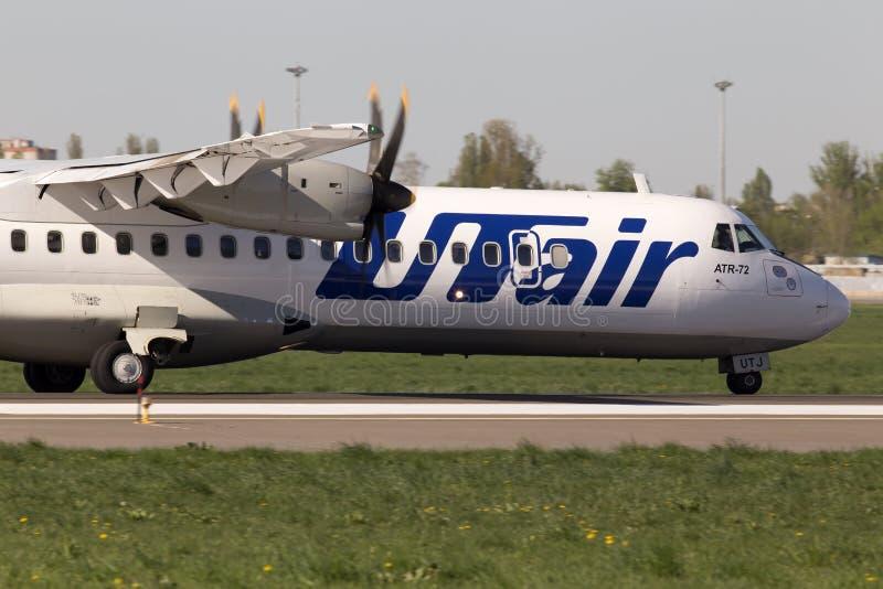Utair-Ukraine Airlines ATR-72 aircraft landing on the runway royalty free stock photos