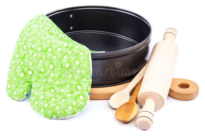 Utensili da cucina per cuocere sul fondo bianco fotografia stock