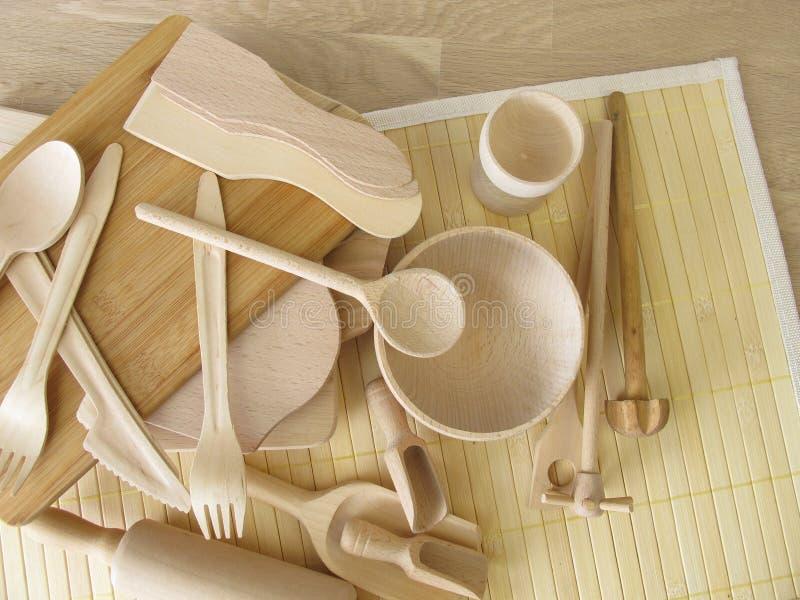 Utensilios libres de la cocina del plástico hechos de la madera fotografía de archivo libre de regalías