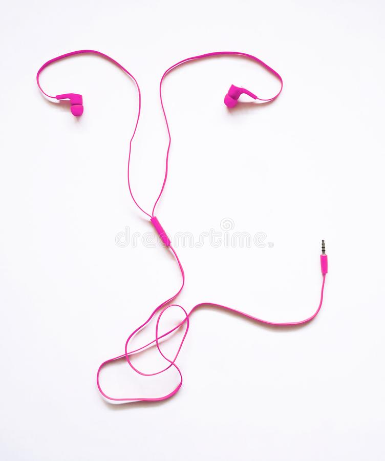 Uterus shaped earphones stock photo